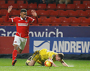 Charlton Athletic defender Tareiq Holmes-Dennis makes a mistimed challenge to earn a yellow card during the Sky Bet Championship match between Charlton Athletic and Nottingham Forest at The Valley, London, England on 2 January 2016. Photo by Andy Walter.