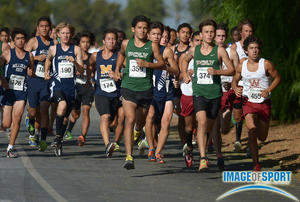 Oct 2, 2013; Long Beach, CA, USA; Zachary Ponce (359) and Christian Vasquez (374) of Long Beach Poly lead the boys race in the first Moore League cluster meet at El Dorado Park. Ponce finished second in 15:47 and Kerr was sixth in 16:04 for Poly, which took the first four places and five of the top six.