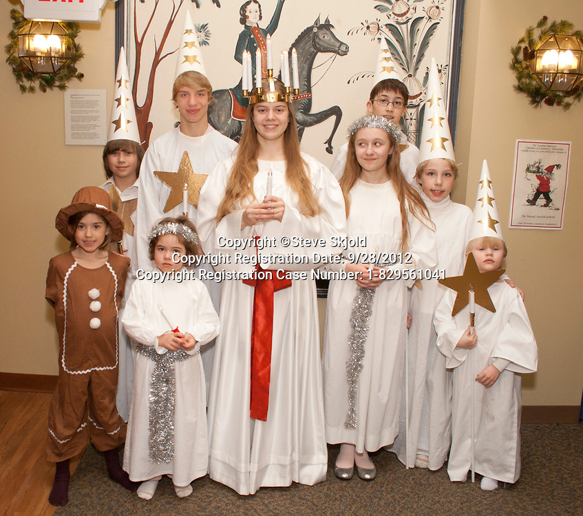 St Lucia day celebration troupe. Annual Swedish Christmas Julbord at the American Swedish Institute Minneapolis Minnesota MN USA
