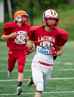 Ryan Chiasson and Kaleb Petell run the ball during Thursday afternoon practice under the concussion protocol of no contact drills.  (Karen Bobotas/for the Laconia Daily Sun)