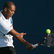 August 15, 2014, New Haven, CT:<br /> Punch Maleka hits a backhand during a US Open National Playoff match against Alexander Centenari during the 2014 Connecticut Open at the Yale University Tennis Center in New Haven, Connecticut Friday, August 15, 2014.<br /> (Photo by Billie Weiss/Connecticut Open)