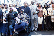 The Rev. Al Sharpton pushes the wheelchair of Trent Benefield as he leads a  silent march down Fifth Avenue  ''to shop for justice,'' in the police shooting incident that killed Sean Bell and wounded Benefield and one other of his friends on his wedding day in New York, December 16, 2006. .Photo by Keith Bedford<br />