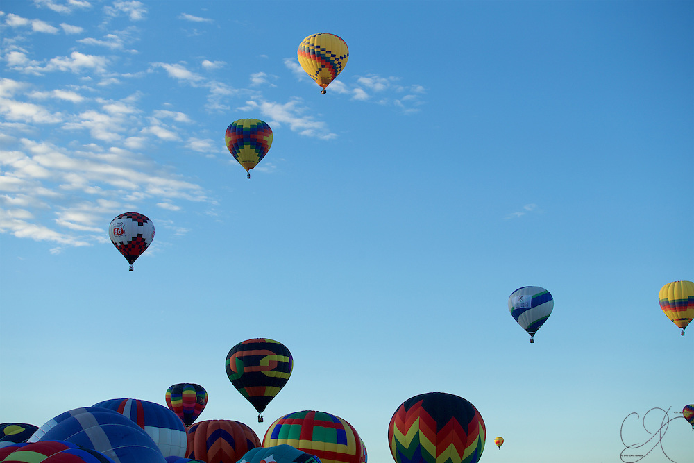 Watching the sky fill with balloons to the point you struggle to count them all - a mass accession at Balloon Fiesta