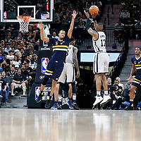 02 April 2017: San Antonio Spurs guard Jonathon Simmons (17) takes a jump shot over Utah Jazz guard Rodney Hood (5) during the San Antonio Spurs 109-103 victory over the Utah Jazz, at the AT&T Center, San Antonio, Texas, USA.
