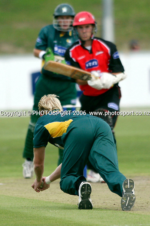 Central District's Brendon Diamante dives to stop the ball during the State Shield cricket match between Canterbury Wizards and Central Stags at QE II Park, Christchurch, New Zealand on Wednesday 3rd January, 2007. Photo: Hagen Hopkins/PHOTOSPORT.