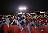 November 18, 2011: Fans in the Iowa State student section storm the field following the end of the NCAA football game between the Oklahoma State Cowboys and the Iowa State Cyclones at Jack Trice Stadium in Ames, Iowa on Friday, November 18, 2011. Iowa State upset Oklahoma State 37-31.