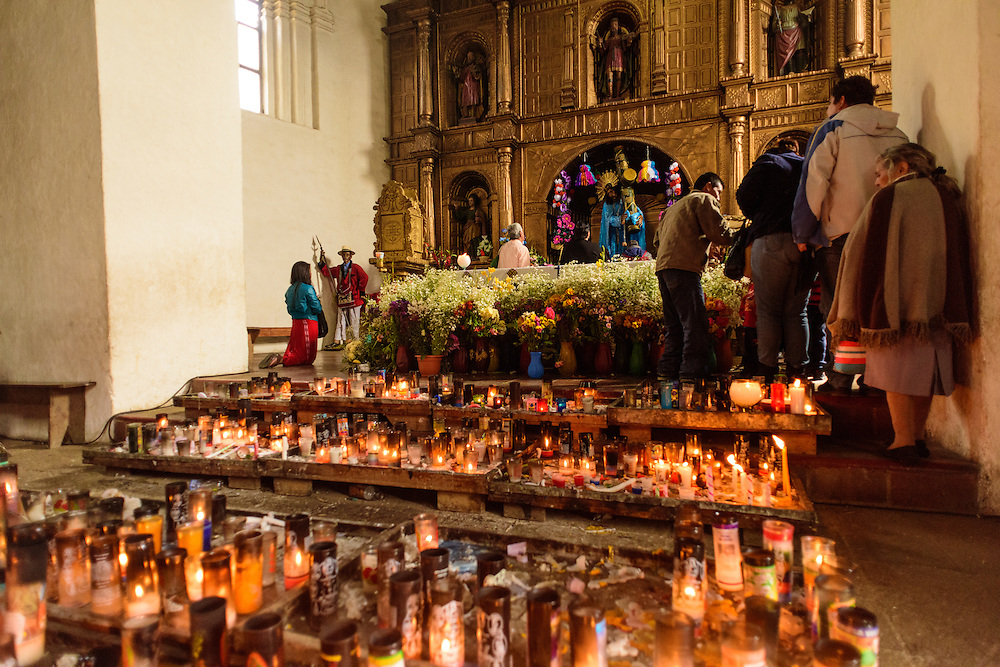 People attending a church with lots of candlelights, Chajul, Guatemala.