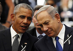 September 30, 2016 - Jerusalem, ISRAEL - U.S. President Barack Obama, left, speaks to Israeli Prime Minister Benjamin Netanyahu during the burial ceremony of former Israeli President Shimon Peres at Mount Herzl Cemetery in Jerusalem, Friday, Sept. 30, 2016. Shimon Peres was being laid to rest on Friday in a ceremony attended by thousands of admirers and dozens of international dignitaries √¢'Ǩ≈°√جø¬Ω√جø¬Ω√É¬Æ in a final tribute to a man who personified the history of Israel during a remarkable seven-decade political career and who came to be seen by many as a visionary and symbol of hopes of Mideast peace. (Credit Image: © Prensa Internacional via ZUMA Wire)