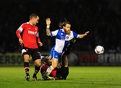Bristol Rovers' Stuart Sinclair tangles with Kidderminster Harriers's Aman Verma and Kidderminster Harriers's Kevin Nicholson - Photo mandatory by-line: Neil Brookman/JMP - Mobile: 07966 386802 - 15/11/2014 - SPORT - Football - Bristol - Memorial Stadium - Bristol Rovers v Kidderminster - Vanarama Football Conference
