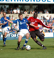 Photo: Tony Oudot.<br /> Millwall v Bristol City. Coca Cola League 1. 28/04/2007.<br /> Tony Craig of Millwall clears from Enoch Showunmi of Bristol City