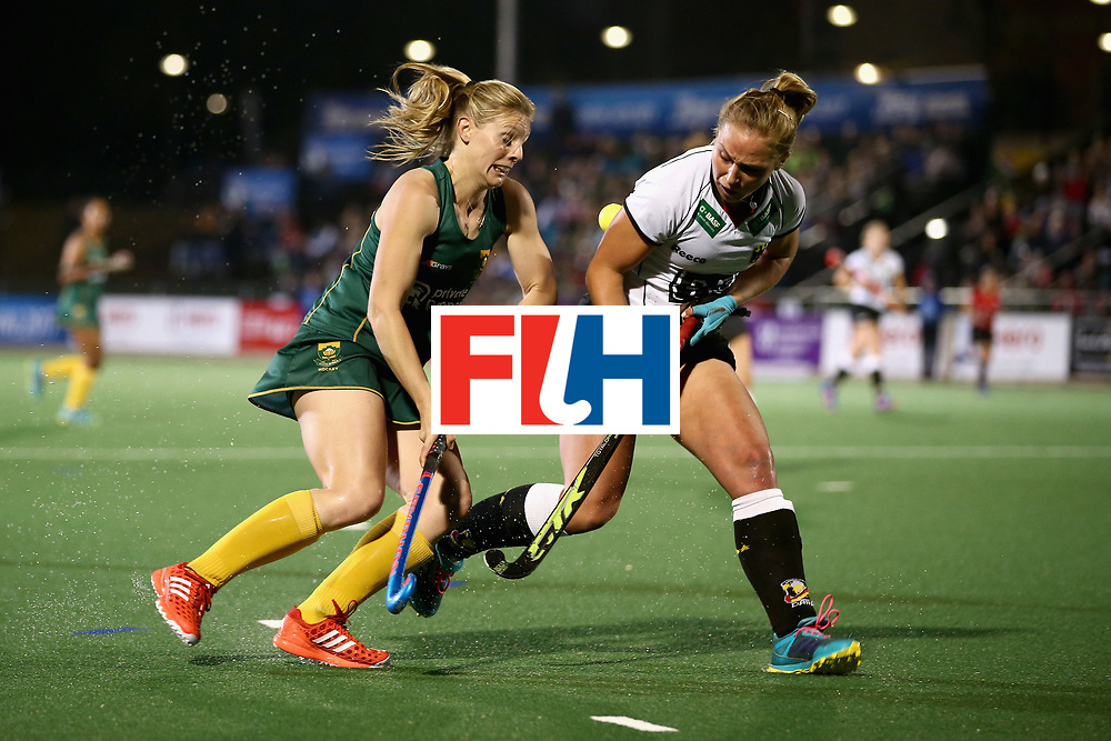 JOHANNESBURG, SOUTH AFRICA - JULY 18: Bernadette Coston of South Africa and Nike Lorenz of Germany battle for possession during the Quarter Final match between Germany and South Africa during the FIH Hockey World League - Women's Semi Finals on July 18, 2017 in Johannesburg, South Africa.  (Photo by Jan Kruger/Getty Images for FIH)