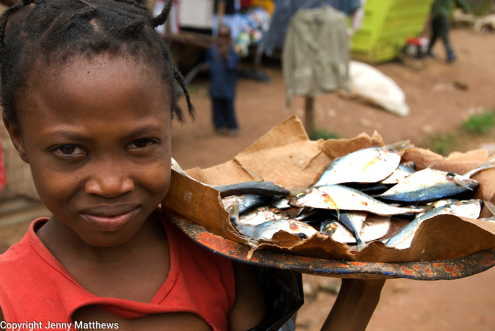 Sierra Leone August 2008<br /> Kabala market. Selling fish - Care has been encouraging the fish sellers with grants
