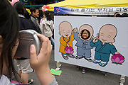 The annual Lotus Lantern Festival is held to celebrate Buddha's Birthday. Picture yourself as a buddhist monk.