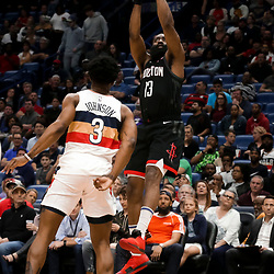 Mar 24, 2019; New Orleans, LA, USA; Houston Rockets guard James Harden (13) shoots over New Orleans Pelicans forward Stanley Johnson (3) during the first quarter at the Smoothie King Center. Mandatory Credit: Derick E. Hingle-USA TODAY Sports