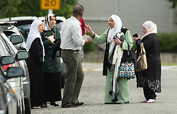 March 15, 2019 - Christchurch, Canterbury, New Zealand - A shocked muslim family outside the mosque following a shooting which resulted in multiple fatalities and injuries at the Masjid Al Noor Mosque, Deans Avenue, Christchurch, New Zealand. At least 49 people were killed and 20 seriously injured in mass shootings at two mosques in the New Zealand city of Christchurch. 48 people, including young children with gunshot wounds, were taken to hospital. Three people were arrested in connection with the shootings. (Credit Image: © Martin Hunter/SNPA via ZUMA Wire)
