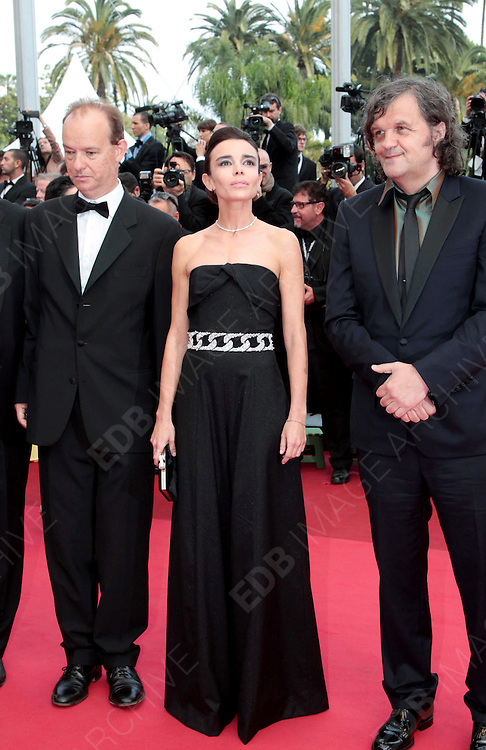 12.MAY.2011. CANNES<br /> <br /> ELODIE BOUCHEZ AND EMIR KUSTURICA ARRIVING ON THE RED CARPET FOR THE SLEEPING BEAUTY PREMIERE AT THE 64TH CANNES INTERNATIONAL FILM FESTIVAL 2011 IN CANNES, FRANCE.<br /> <br /> BYLINE: EDBIMAGEARCHIVE.COM<br /> <br /> *THIS IMAGE IS STRICTLY FOR UK NEWSPAPERS AND MAGAZINES ONLY*<br /> *FOR WORLD WIDE SALES AND WEB USE PLEASE CONTACT EDBIMAGEARCHIVE - 0208 954 5968*