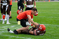 KELOWNA, BC - AUGUST 17:  Kian ISHANI #8 of Okanagan Sun is assisted in a pre game stretch by coachign staff on the field prior to the game against the Westshore Rebels  at the Apple Bowl on August 17, 2019 in Kelowna, Canada. (Photo by Marissa Baecker/Shoot the Breeze)