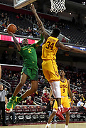 Feb 21, 2019; Los Angeles, CA, USA;  Oregon Ducks forward Louis King (2) is defended by Southern California Trojans forward Victor Uyaelunmo (34) in the first half  at Galen Center. USC defeated Oregon 66-49.