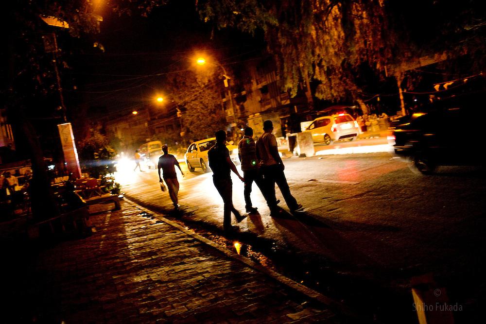 People make their way through blackout in Karadah district, Baghdad in Iraq.