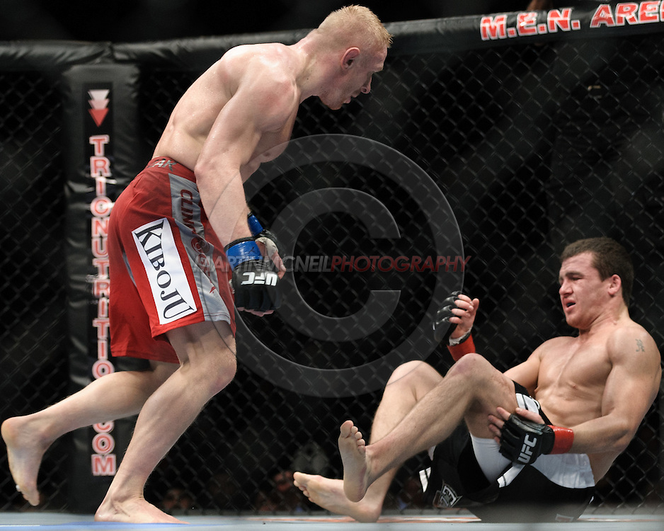 """MANCHESTER, ENGLAND, NOVEMBER 14, 2009: Dennis Siver (left) and Paul Kelly during """"UFC 105: Couture vs. Vera"""" inside the MEN Arena in Manchester, United Kingdom."""