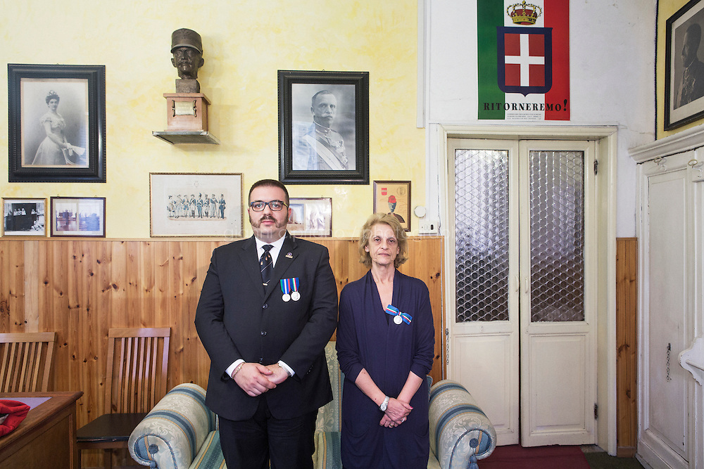 ROME, ITALY - 29 JULY 2014: (L-R) Honor Guards to the royal tombs of the Pantheon Alberto di Maria (29), an event organizer, and Franca Sciaraffia, a retired university professor, pose for a portrait at the National Institute for the Honor Guardsto the royal tombs of the Pantheon in Rome, Italy, on July 29th 2014.<br /> <br /> The National Institute for the Honor Guards to the royal tombs of the Pantheon is a monarchic-oriented whose goal is to watch over the royal tombs at the Pantheon. Italy&rsquo;s first king, Vittorio Emanuele II and his son Umberto I, as well as Umberto's wife Queen Margherita are entombed in the Pantheon.