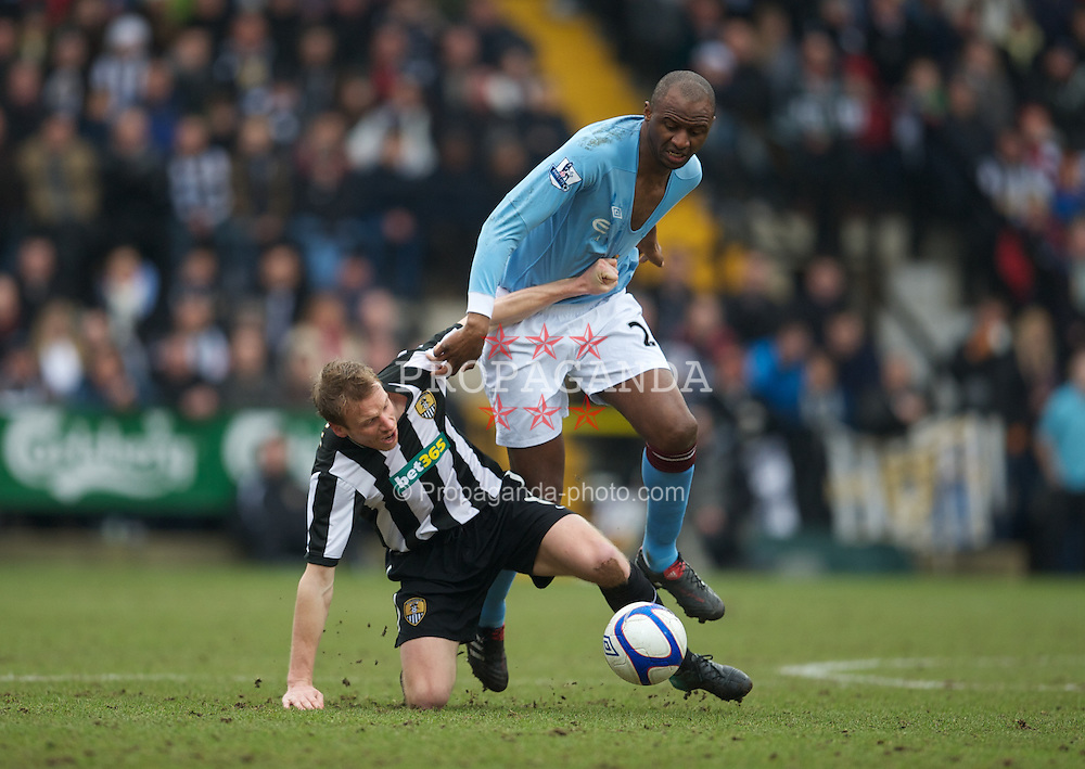 NOTTINGHAM, ENGLAND - Sunday, January 30, 2011: Manchester City's Patrick Vieira and Notts County's Ricky Ravenhill during the FA Cup 4th Round match at Meadow Lane. (Photo by David Rawcliffe/Propaganda)