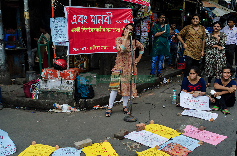 June 16, 2017 - Kolkata, west bengal, India - Kolkata, West Bengal ,India : The Modi government has imposed a 12% G.S.T on sanitary napkins, while traditional patriarchal marker symbols like Sindoor have been made tax free. Out of 33 crore 50 lakh .women who menstruate in this country, only 30% have access to sanitary napkins, the rest 70% are compelled to use sand and dry wood, thereby causing cervical cancer which takes away 80,000 lives .yearly. Instead of making sanitary health widely accessible, the imposition of 12% G.S.T. makes the right to sanitary health more rare and limited, confined to a few and subject to the directives of world .capitalism, international pharmaceutical lobbies and the Modi Government. This tax reinforces the traditional patriarchal stigma and taboo upon such a normal bodily process as menstruation. An .humanitarian activist group of Kolkata called ' ebong Manobi ' organised a programme infront of Jadavpur university to aware people and to raise voice  against this heinous tax. (Credit Image: © Debsuddha Banerjee via ZUMA Wire)