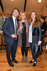 Left to right, JAMIE CARTER, his wife LISA CARTER and CHLOE GRANT at a party to celebrate the publication of 'Inspire: The Art of Living With Nature' by Willow Crossley held at Anthropologie, 131-141 Kings Road, London on 13th March 2014.