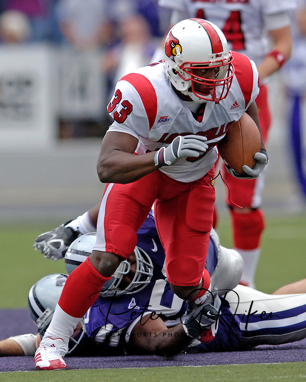 Louisville running back Kolby Smith (33) rushes up field against Kansas State at Bill Snyder Family Stadium in Manhattan, Kansas, September 23, 2006.  The 8th ranked Louisville Cardinals beat K-State 24-6.