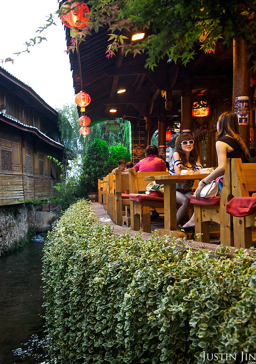 Visitors to the ancient Lijiang town in Yunnan province, southwestern China.