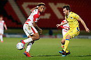 Mallik Wilks of Doncaster Rovers flicks the ball on during the EFL Sky Bet League 1 match between Doncaster Rovers and Bristol Rovers at the Keepmoat Stadium, Doncaster, England on 26 March 2019.