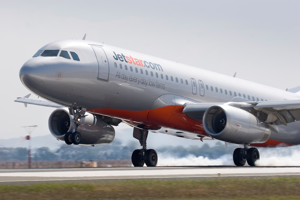 A Jetstar Airbus A320 VH-VQG lands at Avalon with a puff of smoke from the tyres