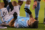 Manchester City forward Sergio Aguero  lies injured after scoring during the Barclays Premier League match between Sunderland and Manchester City at the Stadium Of Light, Sunderland, England on 2 February 2016. Photo by Simon Davies.