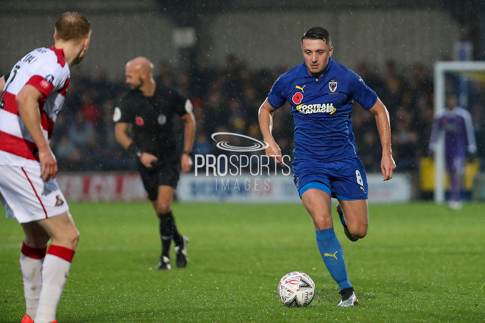 AFC Wimbledon midfielder Anthony Hartigan (8) dribbling during the The FA Cup match between AFC Wimbledon and Doncaster Rovers at the Cherry Red Records Stadium, Kingston, England on 9 November 2019.