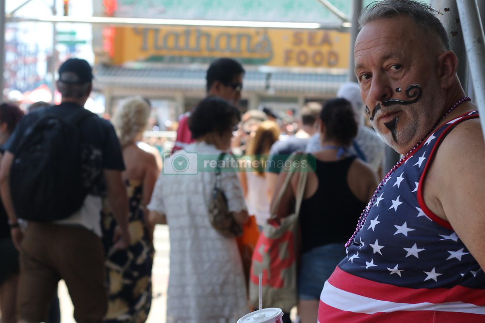 June 16, 2018 - New York City, New York, US - The 36th. edition of the Mermaid Parade drew thousands of mermaids and revelers to the popular sea-side attraction of  Coney Island, Brooklyn, New York on 16th. June 2018. The annual spectacle featured a vast array of costumes. Some, elaborate, others simple and many barely there. (Credit Image: © G. Ronald Lopez via ZUMA Wire)