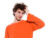 young thinking sleepy caucasian man portrait in studio on white background