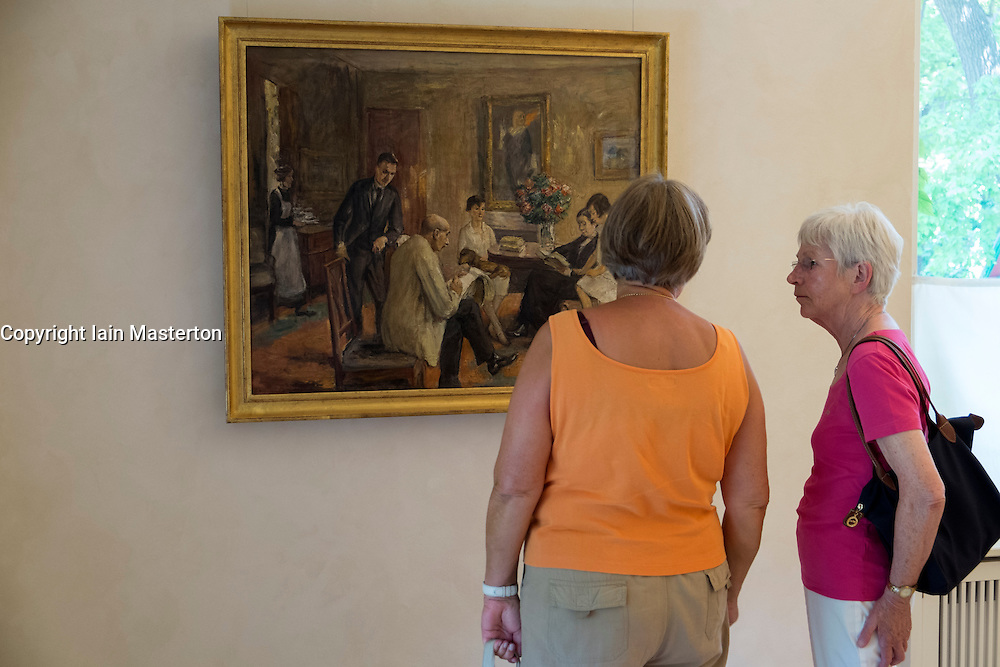 Visitors looking at paintings at Summer house of German artist Max Liebermann in Wannsee Berlin Germany