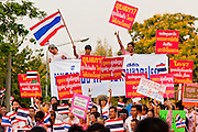 "Apr. 2, 2010 - BANGKOK, THAILAND: Thousands of ""Pink Shirts"" gathered in Lumpini Park in central Bangkok Friday evening to call for ""peace in the land,"" a play on the Red Shirts slogan, ""Red in the Land."" The ""Pink Shirts"" represented educators, business people and people in the tourist industry, all of which have been hurt by the ongoing political protests that have disrupted life in the Thai capital. The ""Pink Shirts"" stressed their loyalty to His Majesty Bhumibol Adulyadej, the King of Thailand, and chanted for the Red Shirts to ""Get Out!"" of Bangkok.    PHOTO BY JACK KURTZ"
