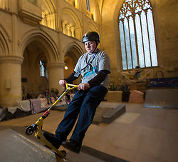 &copy; Licensed to London News Pictures 15/02/2017, Malmesbury, UK. The &quot;Malmesbury Abbey Skate&quot; now in its's 9th year, where the interior of the 12th century abbey in Malmesbury, Wiltshire is turned into a skate park for 3 days during the February half term. Pictured here: 15 year old George Mcgrory on his scooter.<br /> Photo Credit : Stephen Shepherd/LNP