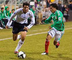 United States forward Brian Ching (11) dribbles past Mexico midfielder Israel Martinez (14).  The United States men's soccer team defeated the Mexican national team 2-0 in CONCACAF final group qualifying for the 2010 World Cup at Columbus Crew Stadium in Columbus, Ohio on February 11, 2009.
