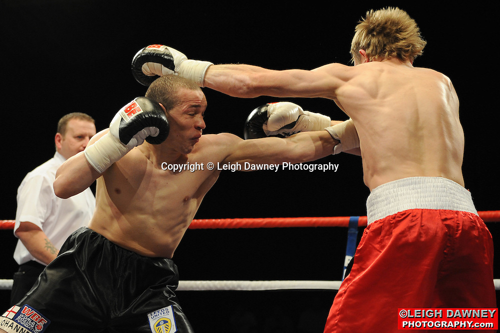 Carl Johanneson (black shorts) defeats Arek Malek at Huddersfield Leisure Centre on 28th May 2010. Frank Maloney Promotions. Photo credit: © Leigh Dawney
