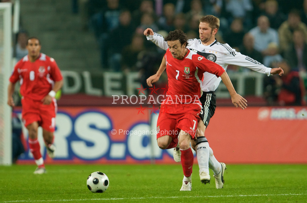MONCHENGLADBACH, GERMANY - Wednesday, October 15, 2008: Wales' Simon Davies and Germany's Thomas Hitzlsperger during the 2010 FIFA World Cup South Africa Qualifying Group 4 match at the Borussia-Park Stadium. (Photo by David Rawcliffe/Propaganda)