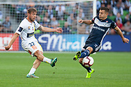 Central Coast Mariners midfielder Jacob Melling (22) goes for a free kick at the Hyundai A-League Round 4 soccer match between Melbourne Victory and Central Coast Mariners at AAMI Park in Melbourne.