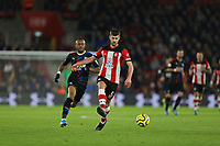 Football - 2019 / 2020 Premier League - Southampton vs. Crystal Palace<br /> <br /> Southampton's Jack Stephens clears from Jordan Ayew of Crystal Palace during the Premier League match at St Mary's Stadium Southampton <br /> <br /> COLORSPORT/SHAUN BOGGUST