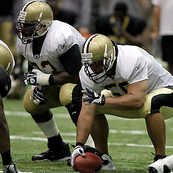 August 5, 2011; Metairie, LA, USA; New Orleans Saints center Olin Kreutz (50) and guard Jahri Evans (73) during training camp practice at the New Orleans Saints practice facility. Mandatory Credit: Derick E. Hingle