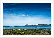 A superb, calm autumn morning at Cloudy Bay, view towards West Cloudy Head [Bruny Island, Tasmania]<br />