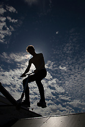 Silhouette of Man Jumping on Ramp at Skate Park