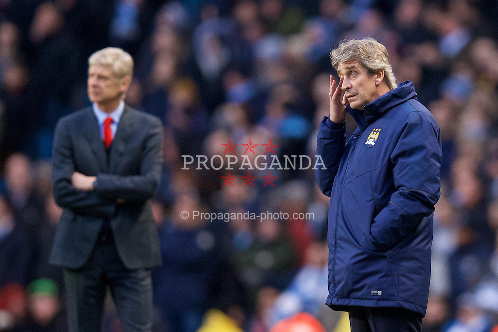 MANCHESTER, ENGLAND - Sunday, January 18, 2015: Manchester City's manager Manuel Pellegrini during the Premier League match against Arsenal at the City of Manchester Stadium. (Pic by David Rawcliffe/Propaganda)