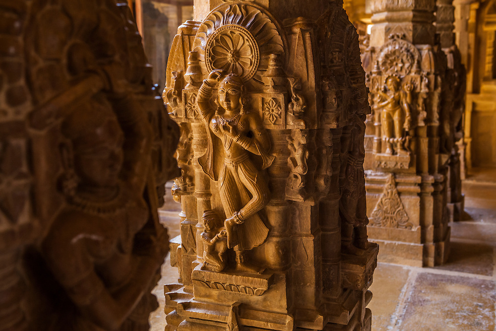 Beautifully carved stone pillars in a Jain temple within Jaisalmer Fort, India.