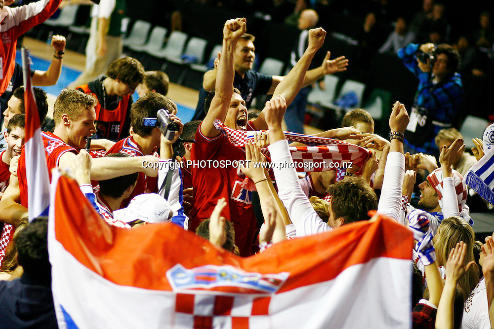 Croatia's players celebrate with their supporters after winning against Australia. U19 Basketball World Championship, 3rd and 4th place game, Australia v Croatia, North Shore Events Centre, Auckland. 12 July 2009. Photo: Anthony Au-Yeung/PHOTOSPORT